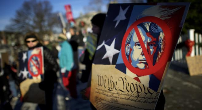 Anti-Donald Trump protesters demonstrate outside the Pennsylvania Capitol Building in Harrisburg before Electoral College voters arrive to cast their ballots for the 2016 presidential race on Dec. 19.