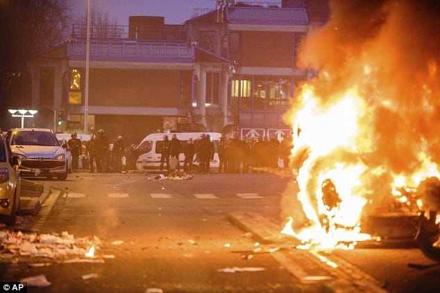 Police in riot gear have come under attack from protesters in Bobigny, near Paris, tonight after a peaceful demonstration over the alleged rape of a 22-year-old man earlier this month