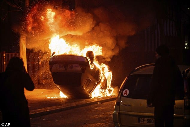 Protesters set alight the car containing the young girl amid violent scenes last night