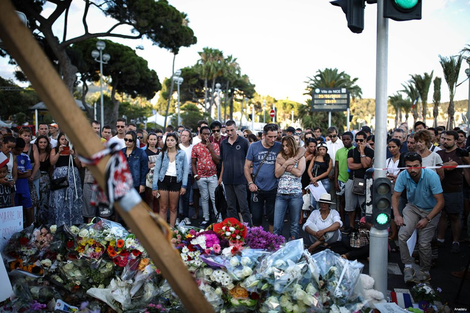 People visit the scene and lay tributes to the victims of the Bastille Day terror attack at the Promenade des Anglais on 15 July, 2016 in Nice, France