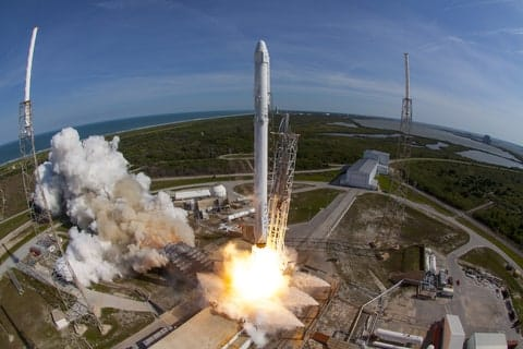 SpaceX Falcon 9 rocket and Dragon spacecraft lift off from Launch Complex 40 at the Cape Canaveral